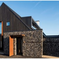 Charred cedar cladding enhanced grain on a house