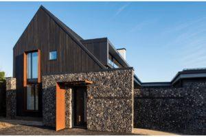 Charred cedar cladding enhanced grain on a house