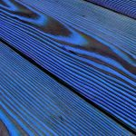 Charred larch coloured blue cladding