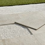 Roxstones exterior tiles in the finish White quartz used in a garden