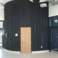 Charred cladding used in contemporary entrance