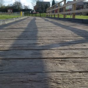 Millboard Vintage Decking used as pathway next to childrens playground