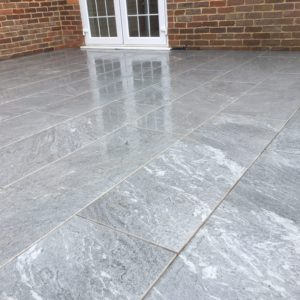 Inner exterior quartzite stone effect tiles used in a garden
