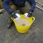 ProJoint™ V75-WT™ Epoxy Resin System being mixed in a yellow bucket