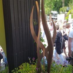 Charred cladding next to garden sculpture used in flower show at RHS Chelsea