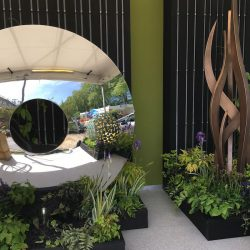 Sarah Naybour garden design with charred cladding in flower show at RHS Chelsea