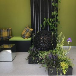 Charred cladding used in Sarah Naybour garden at the flower sow at RHS Chelsea