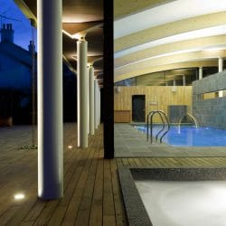 Pool house with contemporary hardwood decking