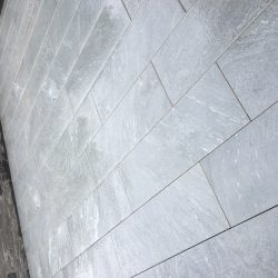 Detail of porcelain tiles laid in garden terrace