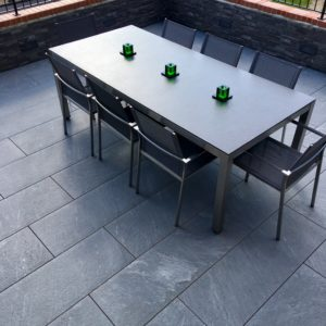 Outdoor furniture on raised grey porcelain tile terrace