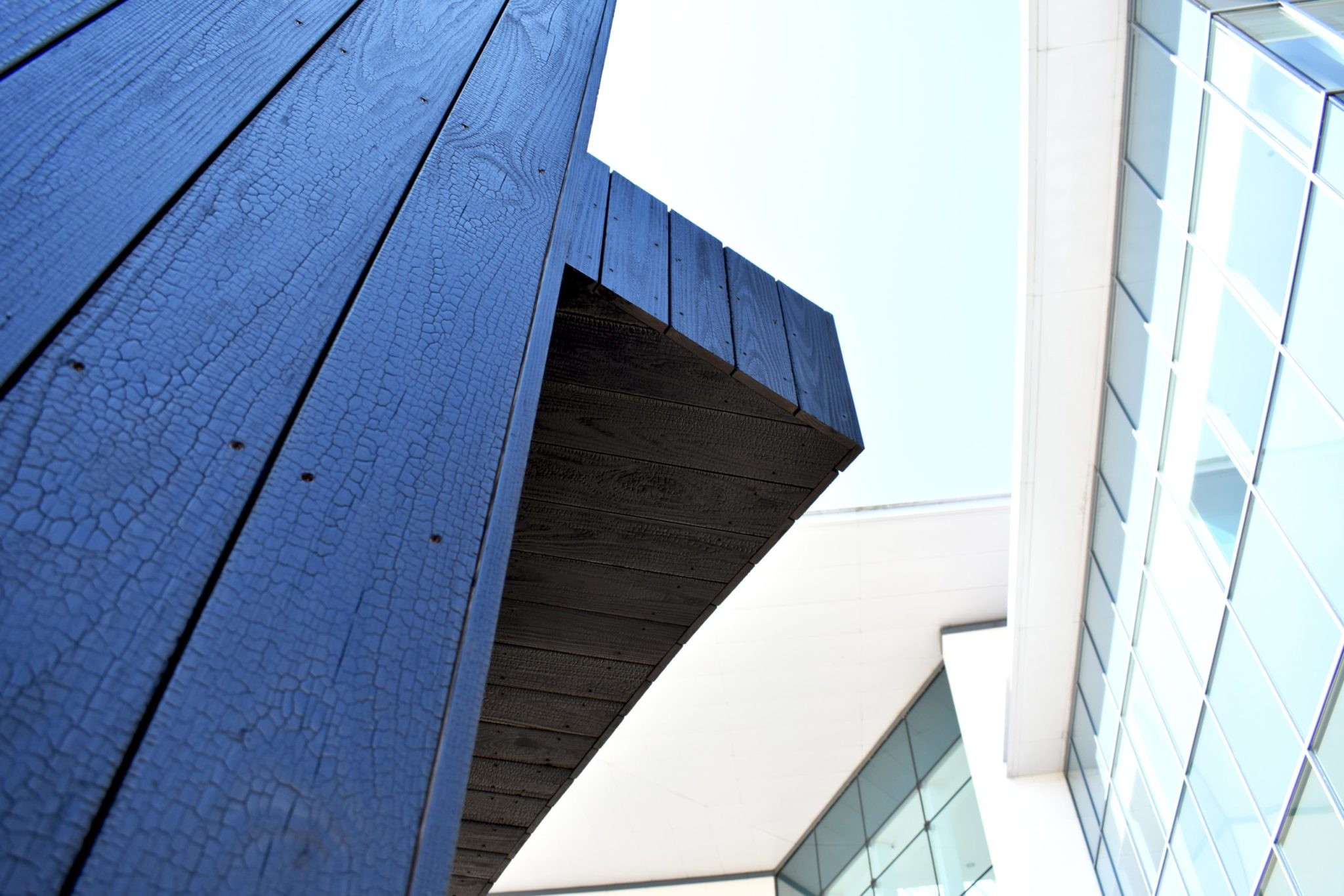 Overhang of coffee house with charred cladding