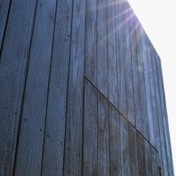 Detail view of coffee pod with charred timber cladding
