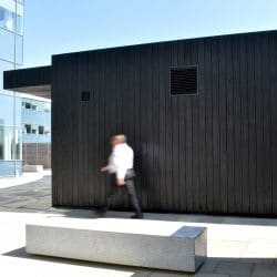 Side view of coffee pod with charred timber cladding