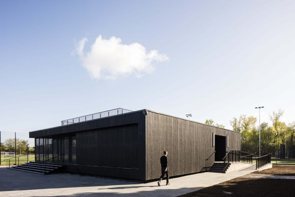 Corner view of Eton College Pavilion Transformed with Charred Timber Cladding