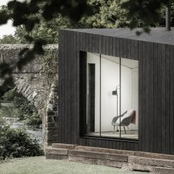 Side view of Koto Cabin with Charred Timber Cladding next to bridge