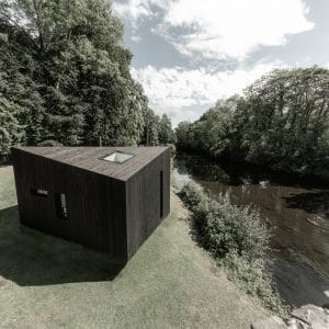 Koto Cabin with Shou Sugi Ban® Charred Timber Cladding next to river