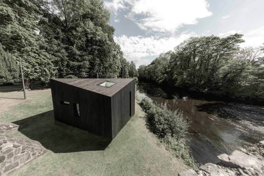 Koto Cabin with Shou Sugi Ban® Charred Timber Cladding next to river