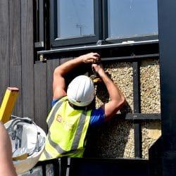 Man installing of Shou Sugi Ban®