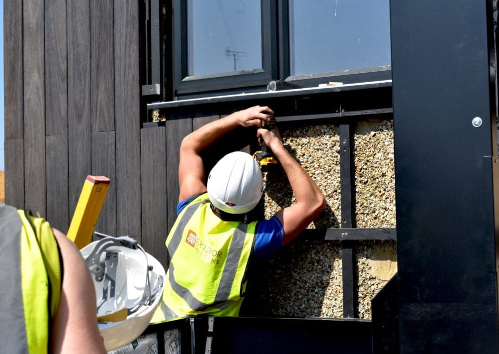 Exterior Solutions team installing Yukari cladding for ITVs Love your Home and Garden