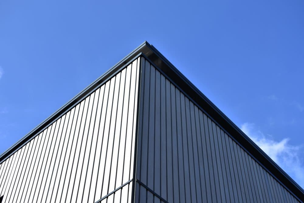 Grey enhanced grain cladding next to blue sky