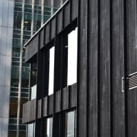 Side of building with Charred Cladding on building in the centre of Canary Wharf