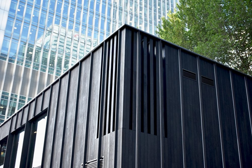 Corner of Charred Cladding on building in the centre of Canary Wharf