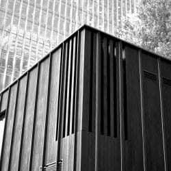 Charred Cladding on building in the centre of Canary Wharf - black and white