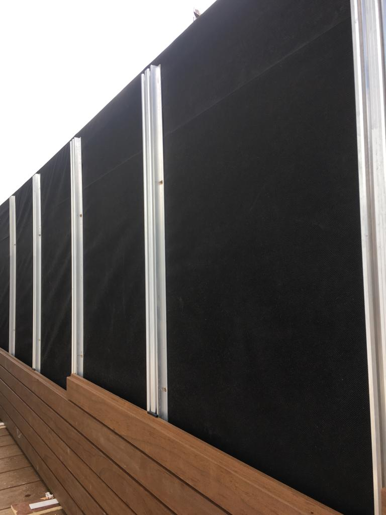 Cladding being installed to the balcony using the Magnet system