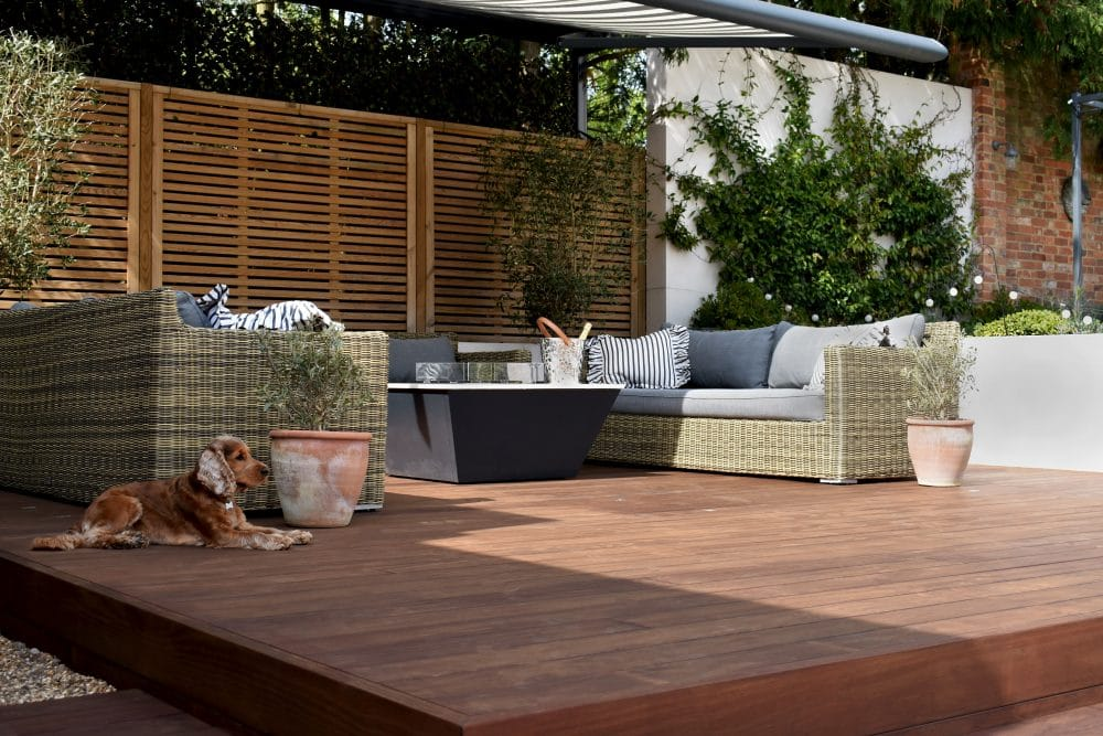 kebony decking terrace with garden furniture and a dog