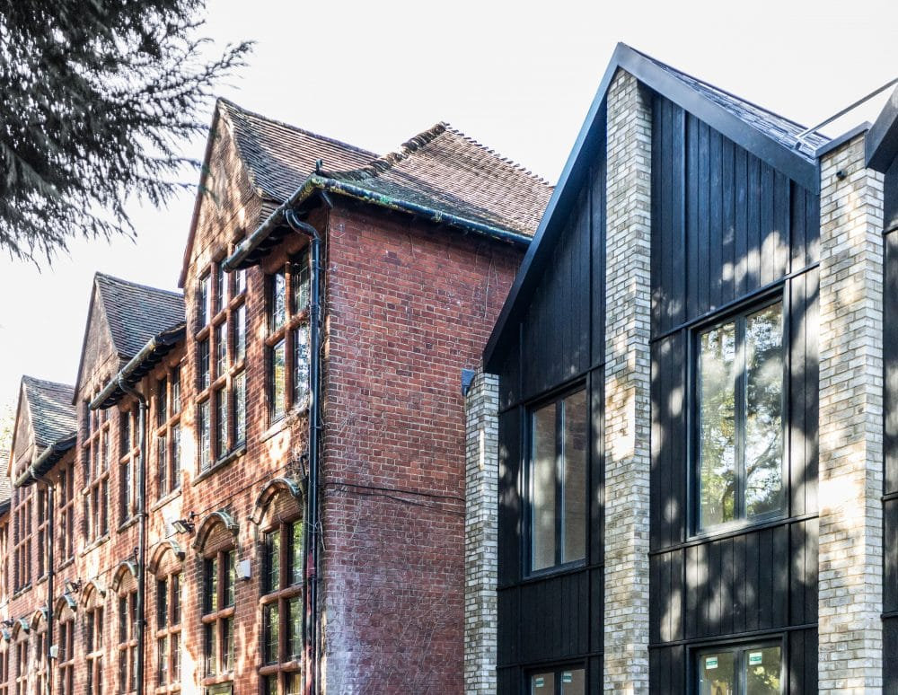 Ewell grove primary school extension clad in shou sugi ban charred timber cladding