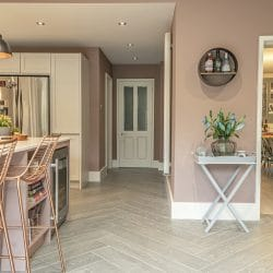 contemporary kitchen designed by watermark featuring wood effect porcelain tiles in herringbone design