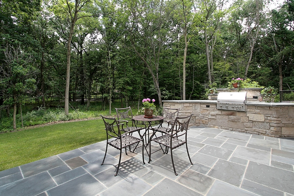 natural stone patio tiles with garden furniture
