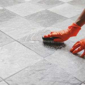 cleaning tiles with a brush